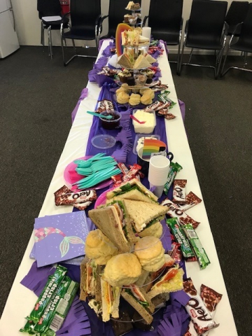 A table full of party food and snacks.